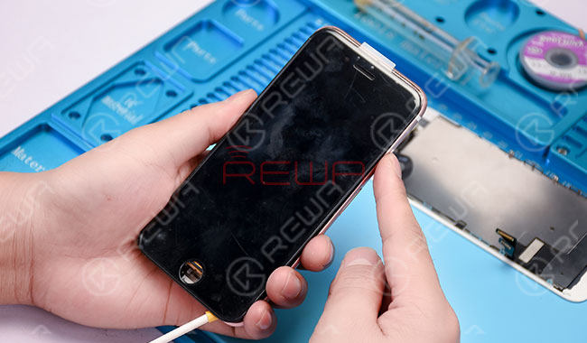 Disconnect the power supply and detach the display assembly. Replace with a new display assembly. Connect the phone with the DC Power Supply and power up. The phone still goes with no display