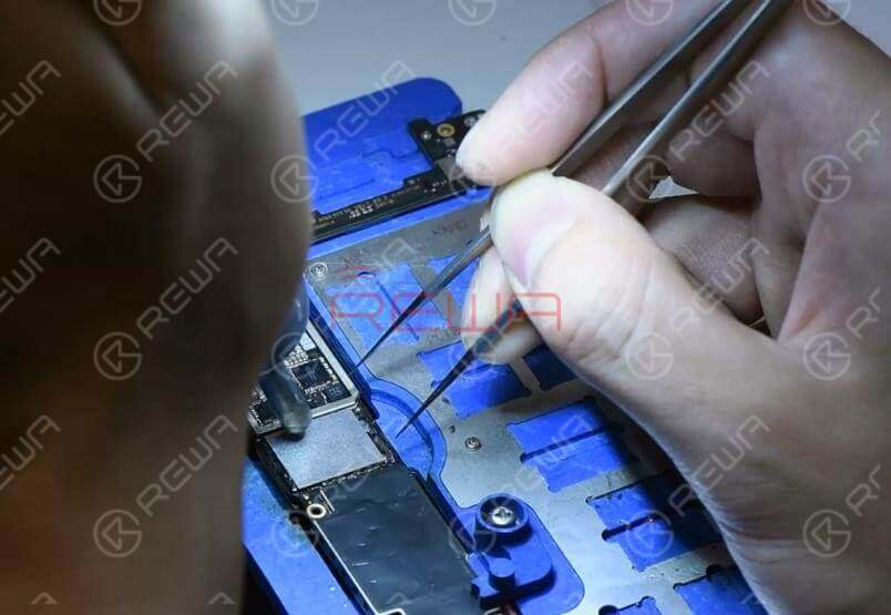 Now we can solder the NAND flash chip and a new WiFi module onto the board.Apply some Paste Flux to the bonding pad. Get the NAND flash chip in position. Make sure you put it in the right direction. Solder with the QUICK 990AD Hot Air Gun.