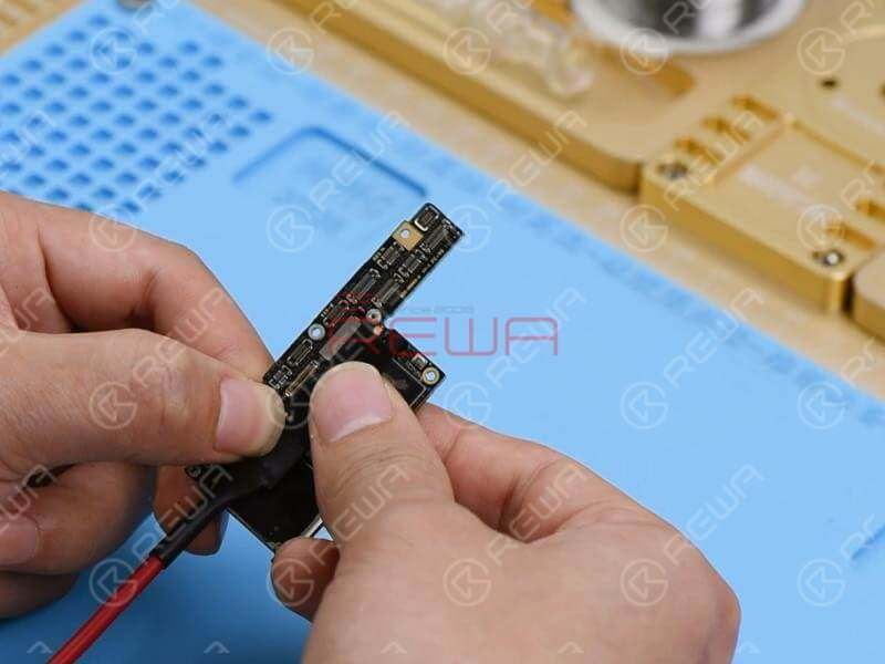 Touch the motherboard with one hand. The NAND flash chip and the area surrounding it are hot. Which indicates that rails on the area might have shorted. Since there are so many components on the hot area, we can locate the faulty component with the help of the Thermal Imager.